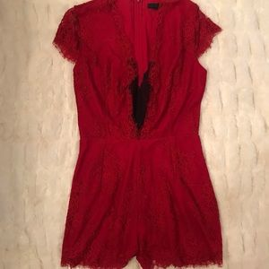 Bebe red lace romper. $219 new. Worn once. Sexy!